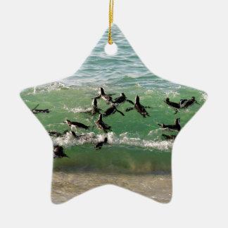 African penguins swimming at beach ceramic ornament
