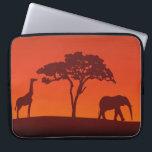 "African Safari Silhouette - Laptop Sleeve<br><div class=""desc"">African safari silhouette background with a giraffe,  a tree and an elephant.</div>"