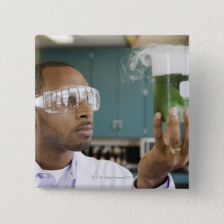 African scientist examining experiment in button