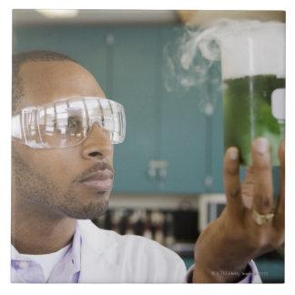 African scientist examining experiment in ceramic tile