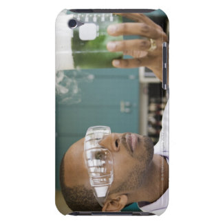 African scientist examining experiment in iPod touch cover