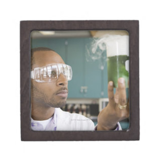 African scientist examining experiment in jewelry box
