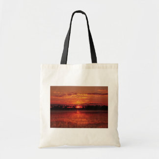 African sunset tote bags