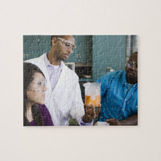 African teacher and students watching experiment puzzle