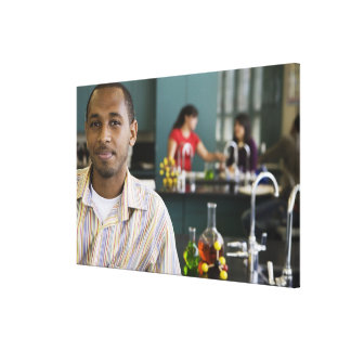 African teacher in chemistry lab gallery wrapped canvas
