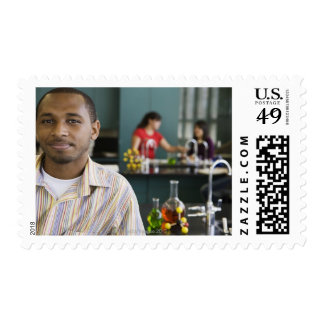 African teacher in chemistry lab postage stamp