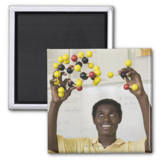 African teenage boy viewing molecule model 2 inch square magnet