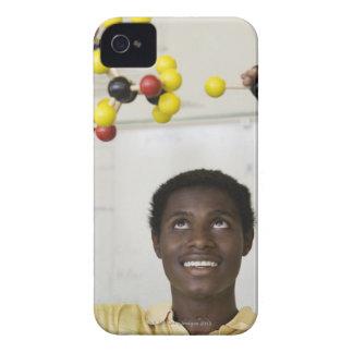 African teenage boy viewing molecule model iPhone 4 case