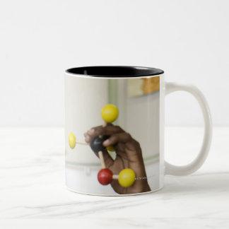 African teenage boy viewing molecule model Two-Tone coffee mug