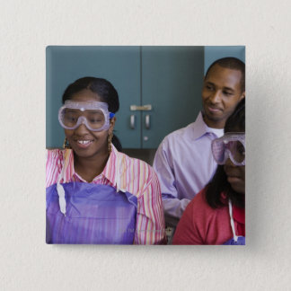 African teenage girl examining experiment in pinback button