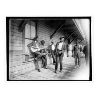 Afroamericanos que esperan el barco c1902 postal