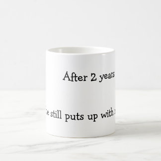 After two years she still puts up with me. coffee mug