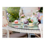 Afternoon tea and cakes in the garden postcard