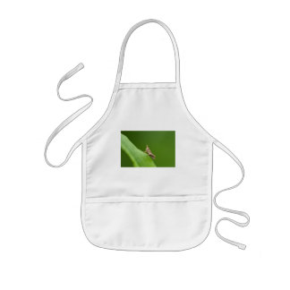 against the green kids' apron