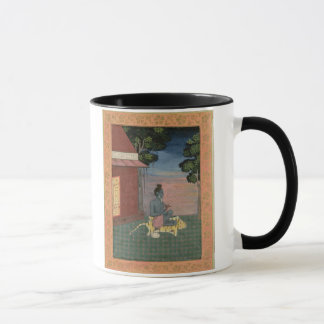 Aged ascetic seated on a tiger skin outside a buil mug