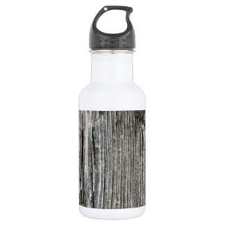 Aged wood fence posting from rustic bush setting water bottle