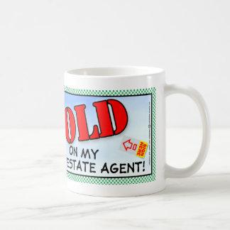 Agente inmobiliario taza