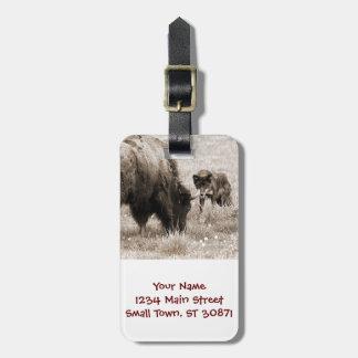 Aggressive wolf hunting bison bag tag
