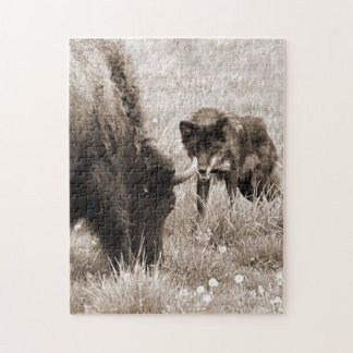 Aggressive wolf hunting bison jigsaw puzzle