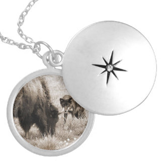 Aggressive wolf hunting bison locket necklace