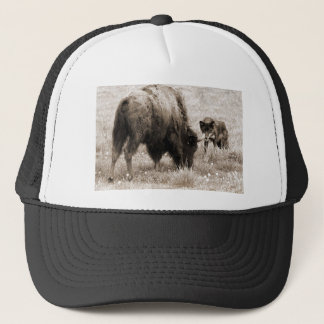 Aggressive wolf hunting bison trucker hat