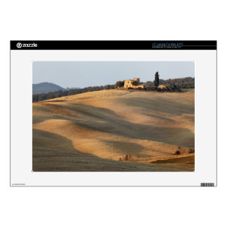 Agricultural field at sunset, Val d'Orcia, Tusca Laptop Skins