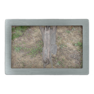 Agricultural old wooden plow on the ground belt buckle