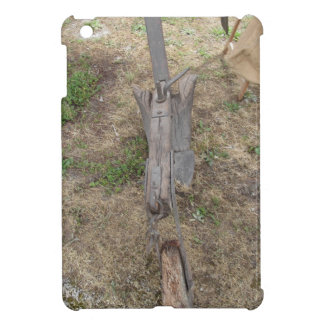 Agricultural old wooden plow on the ground cover for the iPad mini