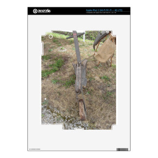 Agricultural old wooden plow on the ground skins for iPad 3