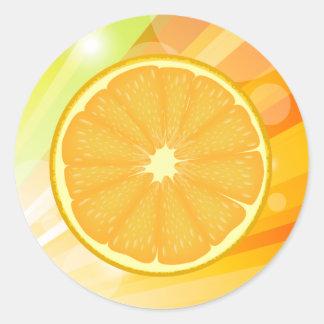 Agrios anaranjados de la rebanada pegatina redonda