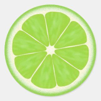 Agrios verdes de la cal pegatina redonda