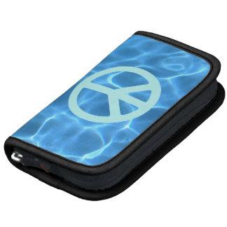Agua azul pálida del símbolo de paz de la turquesa planificadores