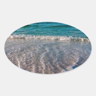 agua cristalina de la Florida en la playa Pegatina Ovalada