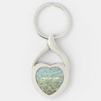 Agua de mar fresca beige azul de la playa llavero plateado en forma de corazón