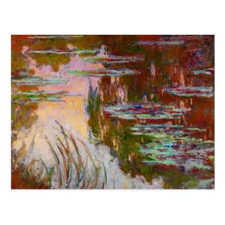 Agua-Lirios, bella arte de Monet del sol poniente Postales