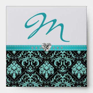 Aguamarina azul y monograma negro del damasco con