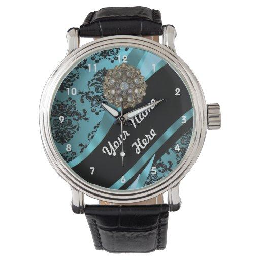 Aguamarina y modelo floral del damasco del negro reloj de mano