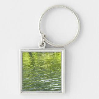 Aguas de la cala del roble amarillas y foto verde llavero cuadrado plateado