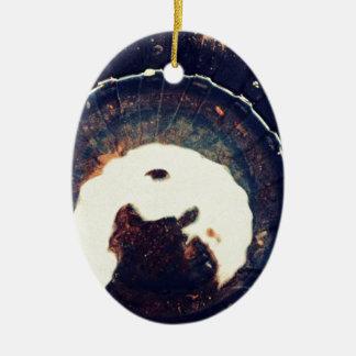 Aguas perturbadas adorno navideño ovalado de cerámica