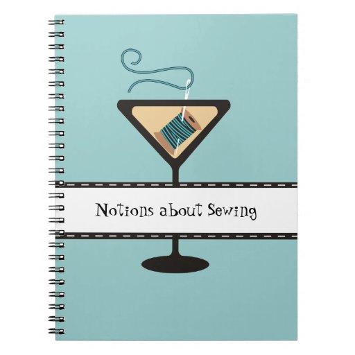 Aguja de cristal de Martini y cuaderno de costura