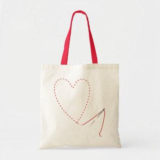 Aguja del corazón y bolso cosidos mano del hilo bolsa