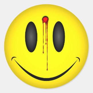 Agujero de bala feliz de la cara pegatina redonda