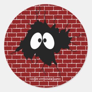 Agujero en los pegatinas de la pared