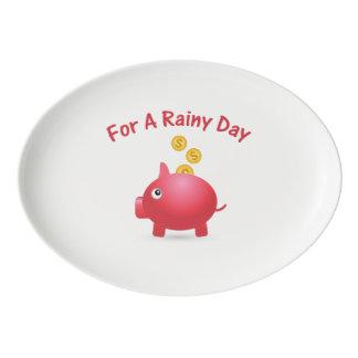 Ahorro guarro por un día lluvioso badeja de porcelana