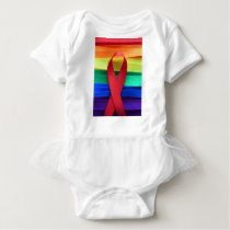 AIDS awareness red ribbon on gay flag Baby Bodysuit