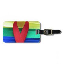 AIDS awareness red ribbon on gay flag Bag Tag