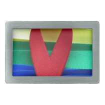 AIDS awareness red ribbon on gay flag Belt Buckle