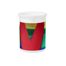 AIDS awareness red ribbon on gay flag Beverage Pitcher