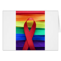 AIDS awareness red ribbon on gay flag Card