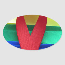 AIDS awareness red ribbon on gay flag Oval Sticker